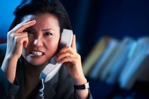 Frustrated Businesswoman on the Phone